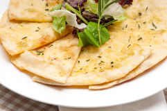 Garlic pita bread pizza with salad on top Royalty Free Stock Photo