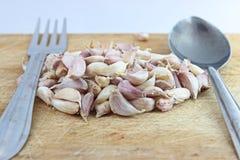 Garlic. Place the garlic on a wooden floor Royalty Free Stock Photos
