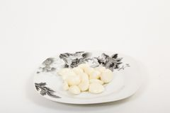 Garlic in a plate Royalty Free Stock Photo