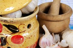 Garlic pot with pestle and mortar. Royalty Free Stock Photo