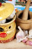 Garlic pot with pestle and mortar. Stock Image