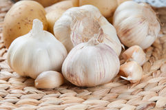 Garlic and potatoes. Potatoes and garlic on the table Royalty Free Stock Photography