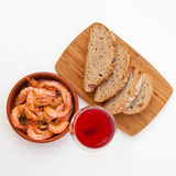 Garlic prawns in a terracotta dish Royalty Free Stock Photo