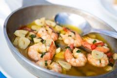 Garlic prawns. Traditional portuguese dish of prawns in garlic Royalty Free Stock Images