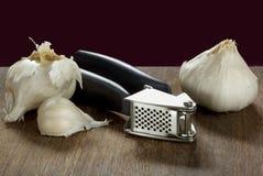 Garlic Press and Bulbs Royalty Free Stock Image
