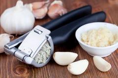 Garlic press and garlic Royalty Free Stock Photo