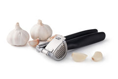 Garlic press and garlic Royalty Free Stock Photo