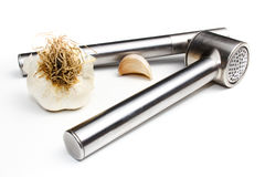 Garlic presser. Garlic clove with masher  white Royalty Free Stock Photo