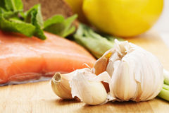 Garlic and raw salmon Royalty Free Stock Photography