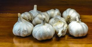 Garlic on a reclaimed hard wood background. Royalty Free Stock Photos