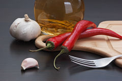 Garlic and red chili peppers Royalty Free Stock Photos