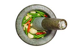 Garlic,Red and Green Chilli in stone mortar and pestle - isolate Stock Photography