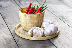 Garlic and red hot chilli peppers  on wooden Royalty Free Stock Photography