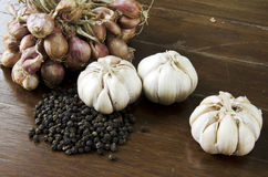 Garlic and red onion. Garlic and red onions with a wooden floor backdrop Stock Photos