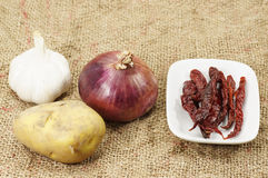 Garlic, Red Onion, Potato and Dry Chili Royalty Free Stock Photos