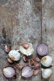 Garlic and red onions on boards Stock Photos