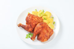 Garlic roasted chicken quarters with potatoes. Garlic roasted chicken leg quarters with boiled potatoes Stock Images