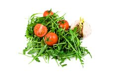 Garlic, ruccola and cherry tomatoes. On white background Stock Photography