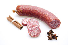 Garlic salami with cinnamon sticks Stock Image