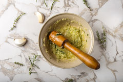Garlic sauce with lemon, thyme and rosemary in bowl Royalty Free Stock Photography