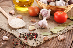 Garlic, sea salt, pepper, sunflower oil, bay leaf, onion and tom Stock Images