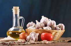 Garlic, sea salt, pepper, sunflower oil, bay leaf, onion and tom Royalty Free Stock Images