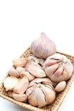 Garlic set. Garlics are setted in wicker basket Royalty Free Stock Images