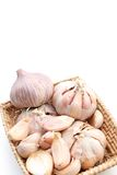 Garlic set. Garlics are setted in wicker basket Stock Image