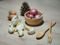 Garlic and Shallot. And a wooden background Royalty Free Stock Image