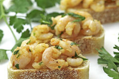 Garlic shrimp tapas on sourdough bread Stock Photos