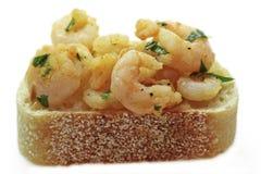 Garlic shrimp tapas on sourdough bread Stock Images