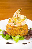 Garlic Shrimps and Latke on a Bed of Lettuce. Two shrimps and latke on a bed of baby lettuce Royalty Free Stock Images