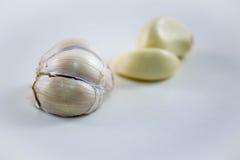Garlic. Skinned garlic on white background Royalty Free Stock Image