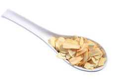 Garlic slices on a spoon Royalty Free Stock Image