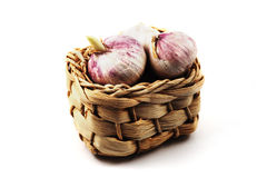 Garlic in a small wicker basket Royalty Free Stock Image
