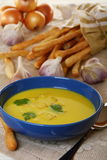 Garlic soup with croutons in a blue cup. Royalty Free Stock Image