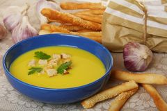Garlic soup with croutons in a blue cup. Royalty Free Stock Photo