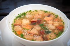Traditional czech soup with croutons . stock images