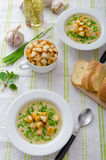 Garlic soup with croutons, spring onions and chives Stock Photo