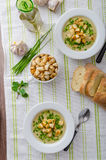Garlic soup with croutons, spring onions and chives Royalty Free Stock Photo