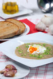 Garlic soup with poached egg Stock Photos