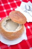 Garlic soup served in a loaf homemade rye flour bread Bowl  (Slovakian cuisine:cesnakova polievka) Stock Image