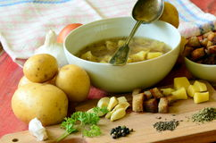 Garlic soup with vintage spoon and ingredients Stock Photos