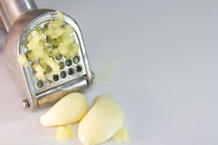 Garlic squeezer Stock Photos