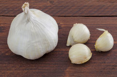 Garlic. Still life of garlic isolated on rustic wooden table in the kitchen of his House royalty free stock photography