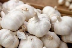 Garlic on street market stand Stock Photos