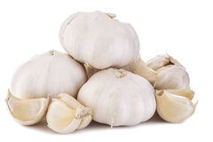 Garlic. Three cloves of garlic arranged Royalty Free Stock Photography
