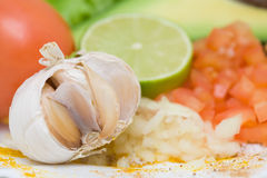 Garlic, tomato, lime Royalty Free Stock Photography