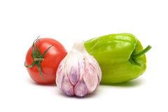 Garlic, tomato and sweet pepper on white background close up Royalty Free Stock Photography