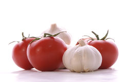 Garlic and tomatos Stock Image